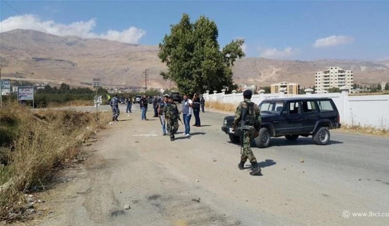 Security officials block off a roadway in Chtaura, Lebanon, after a roadside bomb went off targeting a passenger van transporting travelers to Syria on October 5, 2015. (Photo via LBCI)