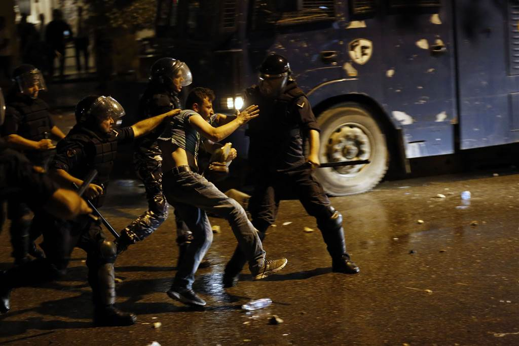 Lebanese security forces detain a protester. (Anwar Amro/AFP/Getty Images)