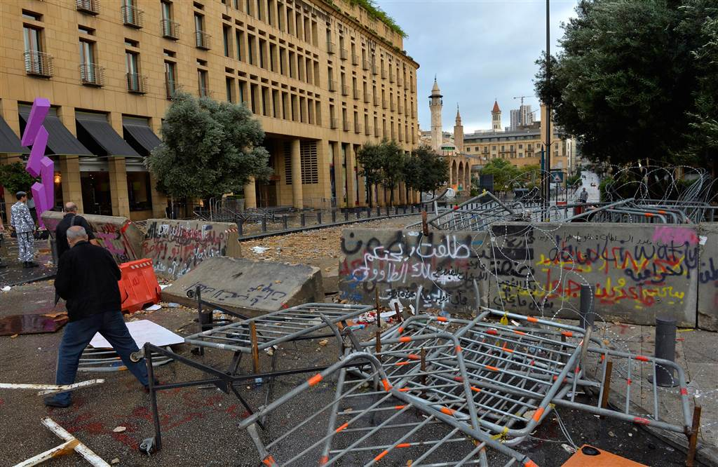 Damage left at the site the clashes fill the street leading to the parliament building on Oct. 9. (Wael Hamzeh/EPA)