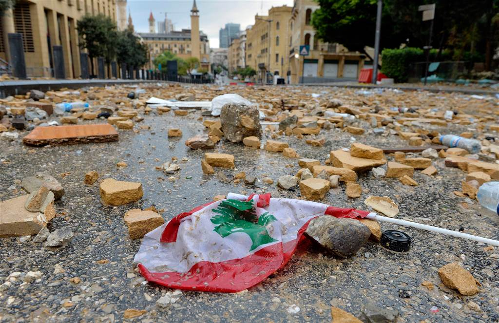 Stones which were hurled at the site of clashes between Lebanese activists and riot police fill the street leading to the parliament building. (Wael Hamzeh/EPA)