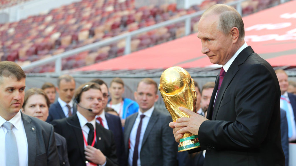 Russian president Vladimir Putin holding the FIFA World Cup Trophy at a pre-tournament ceremony in Moscow, September 2017. (Administration of the President of Russia)