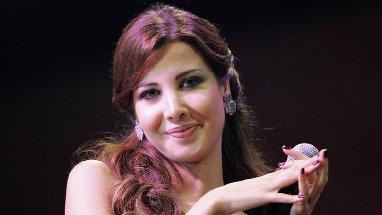 Lebanese singer Nancy Ajram performs during a Lebanese Independence Day concert in Doha November 22, 2007. REUTERS/Fadi Al-Assaad (QATAR)