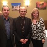 Roger and Randa Naddaf pose with Bishop A. Elias Zaidan.