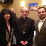 Elie and Marlene Tohme pose with Bishop A. Elias Zaidan.