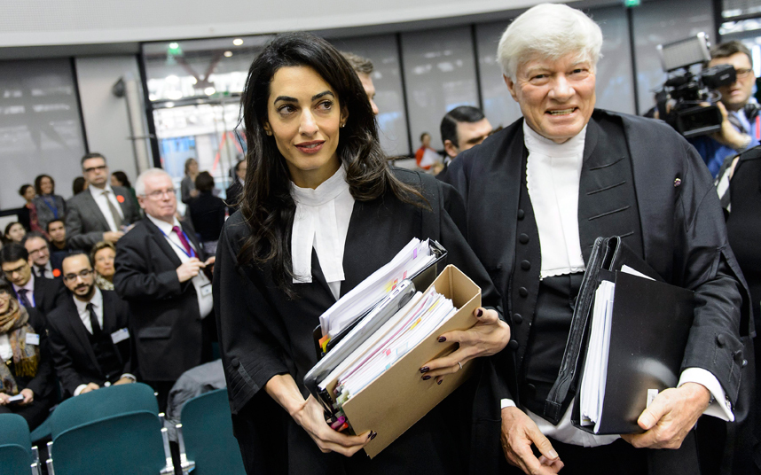 Amal Alamuddin Clooney, left, and Geoffrey Robertson arrive for the hearing in the case Perincek vs Switzerland. Photo: EPA
