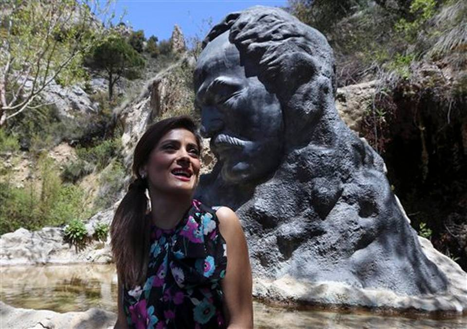 "Mexican and American Salma Hayek sits in front of a statue of Lebanese-American poet Khalil Gibran during her visit to his museum in the northeast mountain town of Bcharre, Lebanon, Sunday, April 26, 2015. Hayek visited her ancestral homeland Lebanon to launch her latest film ""The Prophet,"" a screen adaptation of the book by the same name written nearly a century ago by the famed Lebanese-American poet and philosopher Gibran. Photo: Bilal Hussein, AP"