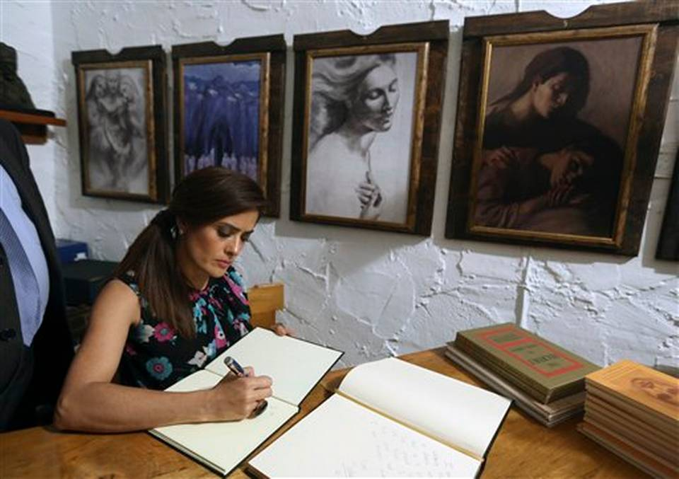 "Mexican and American actress Salma Hayek signs the museum guest book during her visit at the museum of the famed Lebanese-born poet and philosopher Khalil Gibran in the northeast mountain town of Bcharre, Lebanon, Sunday, April 26, 2015. Hayek visited her ancestral homeland Lebanon to launch her latest film ""The Prophet,"" a screen adaptation of the book by the same name written nearly a century ago by Gibran. Photo: Bilal Hussein, AP"
