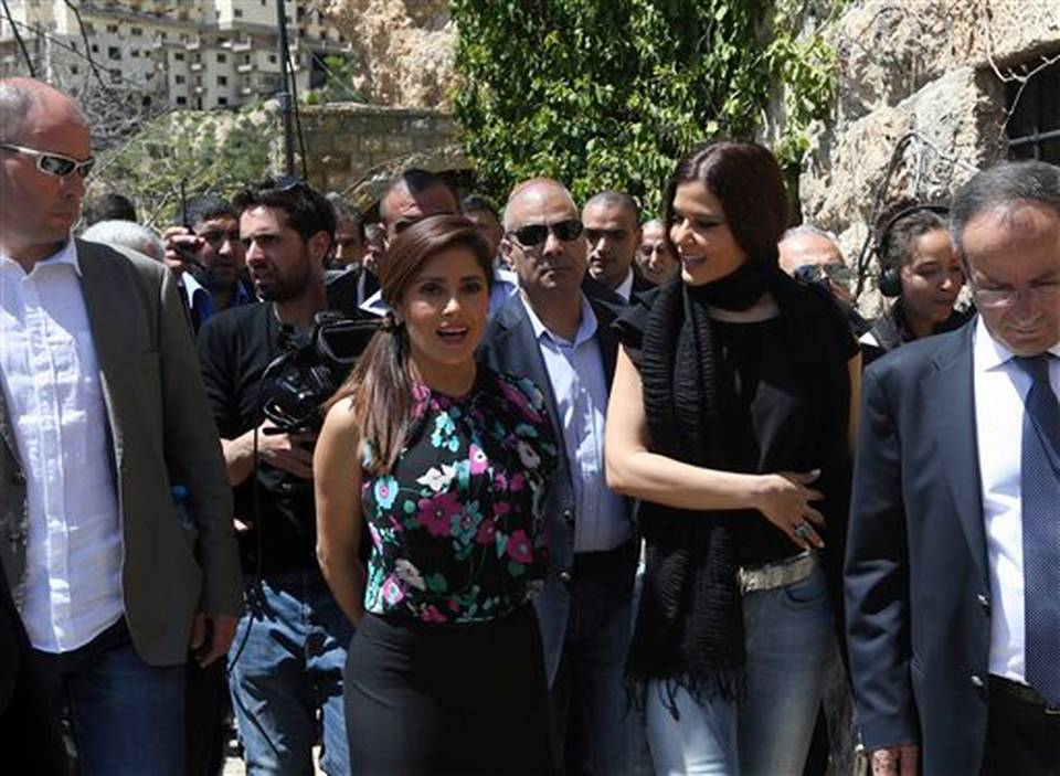"Mexican and American actress Salma Hayek, second left, speaks with Lebanese legislator Setrida Geagea, second right, during her visit to Khalil Gibran's museum in the northeast mountain town of Bcharre, Lebanon, Sunday, April 26, 2015. Hayek visited her ancestral homeland Lebanon to launch her latest film ""The Prophet,"" a screen adaptation of the book by the same name written nearly a century ago by the famed Lebanese-American poet and philosopher Gibran. Photo: Bilal Hussein, AP"