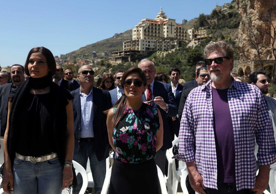 "Mexican and American actress Salma Hayek, center, Lebanese legislator Setrida Geagea, left, and film director Roger Allers, right, stand for the Lebanese and Mexican national anthems during her visit at the museum of the famed Lebanese-born poet and philosopher Khalil Gibran in the northeast mountain town of Bcharre, Lebanon, Sunday, April 26, 2015. Hayek visited her ancestral homeland Lebanon to launch her latest film ""The Prophet,"" a screen adaptation of the book by the same name written nearly a century ago by Gibran.  Photo: Bilal Hussein, AP"