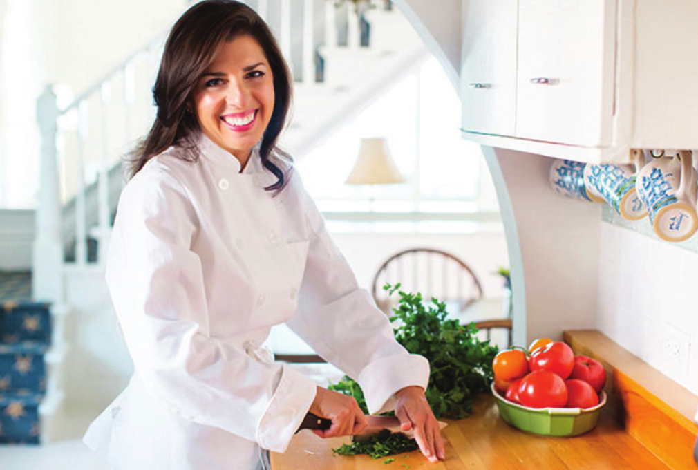 """Michigan-based Lebanese-American food blogger Maureen Abood recently published her first cookbook called, """"Rose Water and Orange Blossoms: Fresh & Classic Recipes from my Lebanese Kitchen."""" (Photo via Maureen Abood)"""