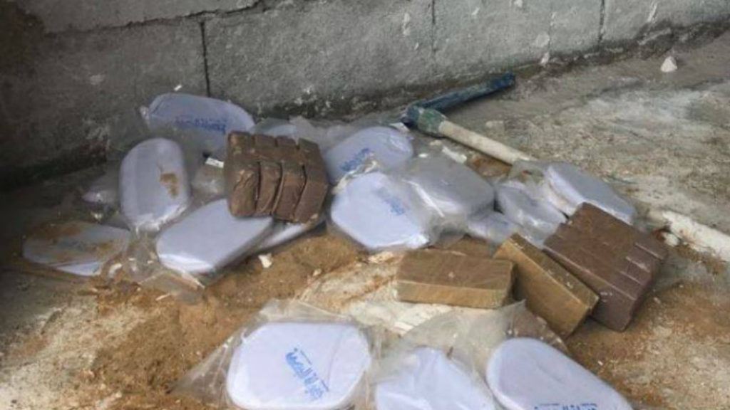 Photos show the marijuana blocks recovered from a warehouse in Ouzai. (Photo provided/Internal Security Forces)