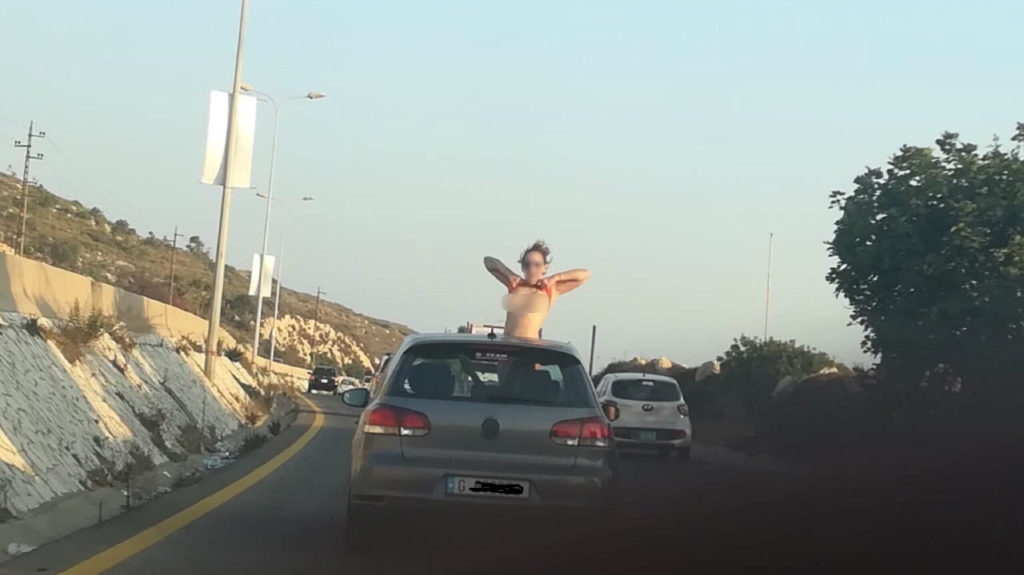 Police in Lebanon are searching for a woman who flashed motorists on a highway in Saida. (YASA)