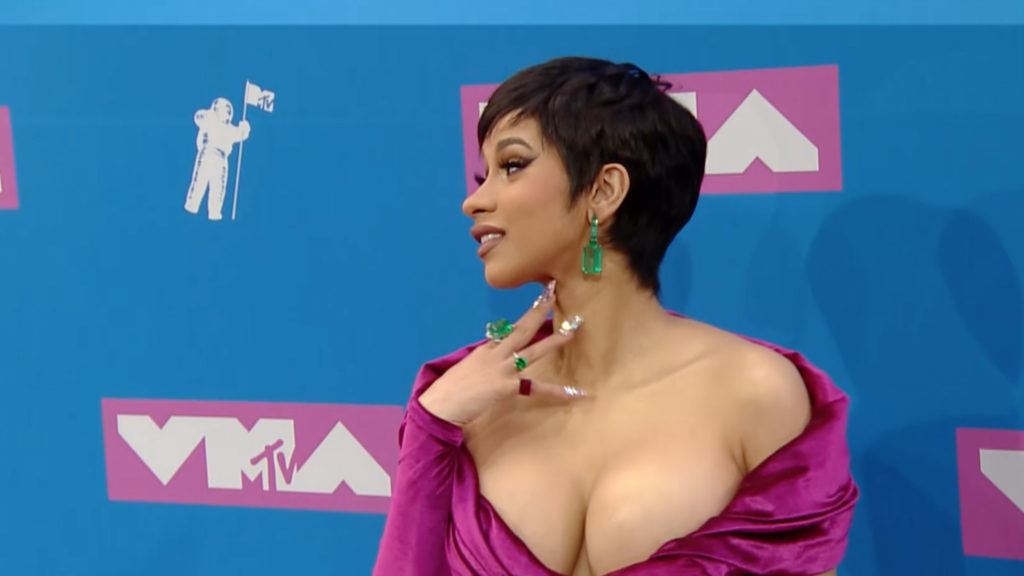 Cardi B wore a fuschia dress by Lebanese designer Nicolas Jebran. (MTV Press)